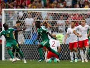 Първи африкански триумф, Полша повалена на дъното на групата СНИМКА