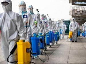 Година след първия случай на корона в Ухан, Китай иска да преразгледа произхода на COVID-19