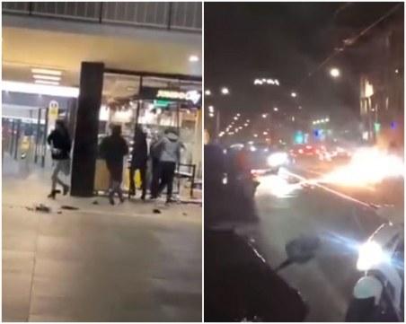 Хаос! Протестиращи разбиват и ограбват магазини в Холандия, палят мотори